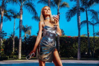 BOOHOO.COM_PARIS HILTON_POOL (574x383)